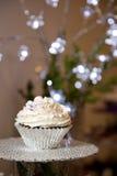 结霜的杯形蛋糕 免版税库存图片
