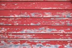 绘削皮红色纹理墙壁 免版税图库摄影