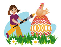 绘复活节彩蛋的女孩 免版税库存照片