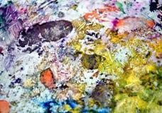 绘的紫罗兰色绿色橙黄色银生动的抽象湿油漆背景 绘画斑点 库存照片