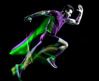 绘黑背景的赛跑者连续慢跑者跑步的人光 免版税图库摄影