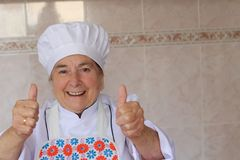 给与copyspace的资深厨师赞许 免版税库存图片