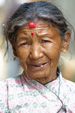 给国家老protrait妇女穿衣 库存照片