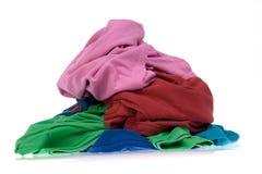 给坏的洗衣店堆穿衣 免版税库存图片