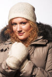 给女孩冬天穿衣 免版税库存照片