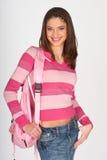 给女孩桃红色青少年穿衣 免版税库存照片