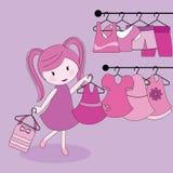 给女孩购物穿衣 免版税库存图片