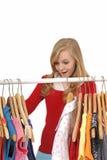 给少年女孩的购物穿衣 库存照片