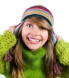 给少年的纵向温暖的女孩穿衣 库存图片