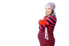 给怀孕的佩带的冬天妇女穿衣 图库摄影
