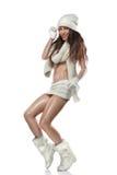 给性感的微笑的白冬天妇女穿衣 库存图片