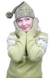 给温暖的女孩穿衣 免版税库存照片
