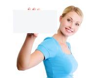 给空白白肤金发的看板卡小的妇女做&# 库存照片