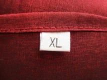 给穿衣的标签 免版税库存照片