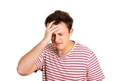 绝望哭泣的人用在头发的手 在白色背景隔绝的情感人 免版税库存照片