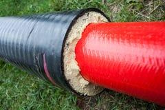绝缘材料 有保冷的管子 免版税库存照片