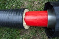 绝缘材料 有保冷的管子 免版税图库摄影