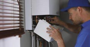 维护和修理服务服务工程师与房子气体加热锅炉一起使用 影视素材