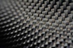 综合产品黑暗的碳纤维材料  免版税库存照片