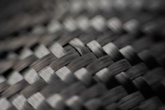 综合产品黑暗的碳纤维材料  库存图片