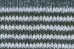 绿化一个白色棉织物组织样式宏指令特写镜头 免版税图库摄影
