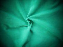 绿色丝绸缎纹理,五颜六色的棉织物背景 免版税库存照片