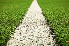 绿色人为草足球场 绿色背景 免版税库存照片