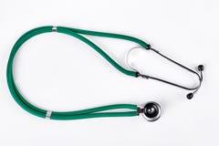 绿色医疗听诊器,白色背景 免版税图库摄影