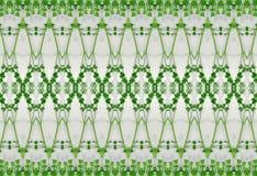绿色叶子的装饰品在冰的 免版税库存图片
