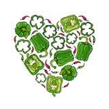 绿色响铃Peper心脏形状花圈 一半胡椒裁减甜辣椒粉和圆环  新鲜的成熟未加工的蔬菜诗歌选 库存照片