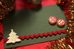 绿色圣诞卡和宾果游戏编号 免版税库存照片