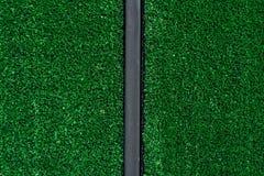 绿色地毯或脚刮板或门前的擦鞋棕垫纹理 免版税库存图片