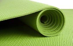 绿色席子瑜伽 免版税图库摄影