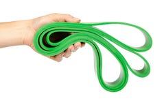 绿色抵抗带用健身体育的手,隔绝在白色背景 图库摄影