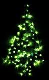 绿色明亮的发光的圣诞树 库存照片
