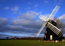 绿色有花边的风车 免版税图库摄影