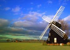 绿色有花边的风车 库存图片