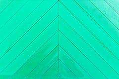 绿色木被绘的墙壁 免版税库存照片