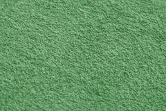 绿色毛巾与迷离作用的表面特写镜头 库存图片