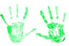绿色油漆印刷品从手,在白色背景的棕榈的 库存图片