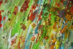 绿色泥,绿色橙色颜色,蜡状的抽象背景 免版税库存图片