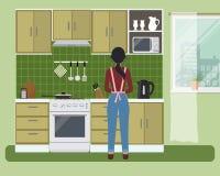 绿色的厨房 有妇女在火炉附近准备食物 皇族释放例证