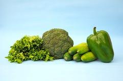 绿色菜在蓝色背景中 免版税库存图片
