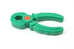 绿色钳子玩具 库存图片
