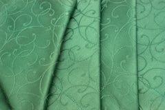 绿色餐巾桌布 免版税库存图片