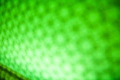 绿色bokeh摘要被弄脏的轻的背景 库存图片