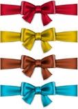 缎颜色丝带。礼物弓。 库存照片