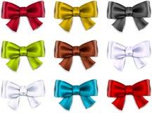缎颜色丝带。礼物弓。 免版税图库摄影