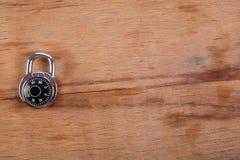 编码锁在木书桌 免版税图库摄影