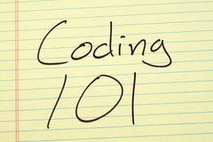 编码101在一本黄色便笺簿 图库摄影